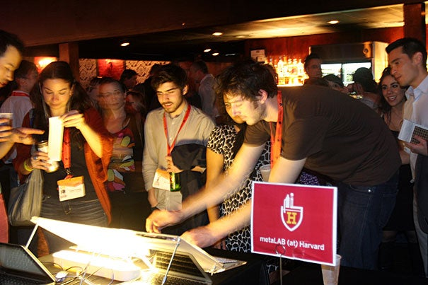 """Attendees at """"Digital Harvard in Austin"""" line up to play a Twitter-based social game created by the metaLAB (at) Harvard."""
