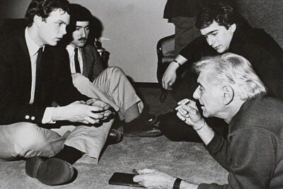 Leonard Bernstein '39 (far right) was a lion of the arts world and a frequent visitor to Harvard over the years. On March 22, GSAS student Matthew Mugmon will be one of seven panelists convened by the New York Philharmonic for a worldwide, online discussion on Bernstein.