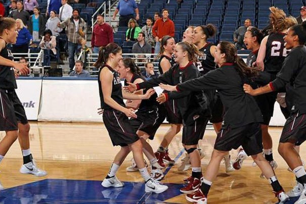 Harvard women's basketball celebrates its win over Hofstra, 73-71 on Thursday. The Ivy League entered this year's tournament a combined 0-5 in the WNIT since 2007 when it first earned an automatic bid. For Harvard, it marks the team's first victory in three tries at the tournament and improves the program to 2-8 all-time in the postseason.