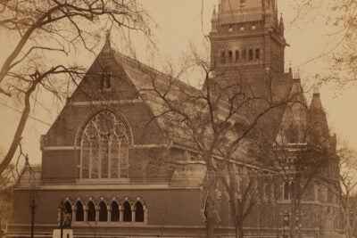 Memorial Hall was to be an ornate Gothic Revival structure, with 5,000 square feet of stained glass, a 210-foot tower, intricate slate roofing, and gargoyles sheathed with copper.