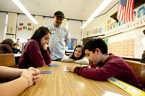Garden Pilot Academy fourth-graders Jade Diaz (far left) and Sebastian Alvarez (far right) were joined by Harvard Graduate School of Education's Alfonso Herrera (standing) and Nell Hutchins during Family Math Night.