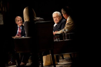 """I know more now, and I probably have a more balanced and slightly less self-confident view,"" said Henry Kissinger (second from right). But ""when you are in office, you have to act under pressure, you have to act as if you're sure of what you're doing, because you don't get rewarded for your doubts."" Kissinger was the feature panelist that included (from far left) Joseph Nye, Jessica Blankshain, and Graham Allison."