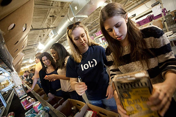Harvard graduate student Yailett Fernandez (from far left), undergrads Winta Haile '12, Anne Cervas '14, and Juliet Spies-Gans '15, volunteered at the Greater Boston Food Bank through Harvard College Serves. Spies-Gans said it was nice to think that the experience of service would be the basis of the relationships she made with her soon-to-be housemates. Spies-Gans will be living in Lowell House this fall.