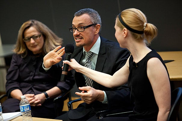 """Artist David Michalek (center) acknowledged that the slowness of the work is at first """"tough to watch,"""" but that as it progresses it inspires viewers to """"investigate the parts"""" of the installation through a type of """"self-guided exploration. Michalek was joined by Giuliana Bruno (left) and Jill Johnson during the discussion of """"Slow Dancing,"""" which is on view through April 29 in Harvard  Yard."""