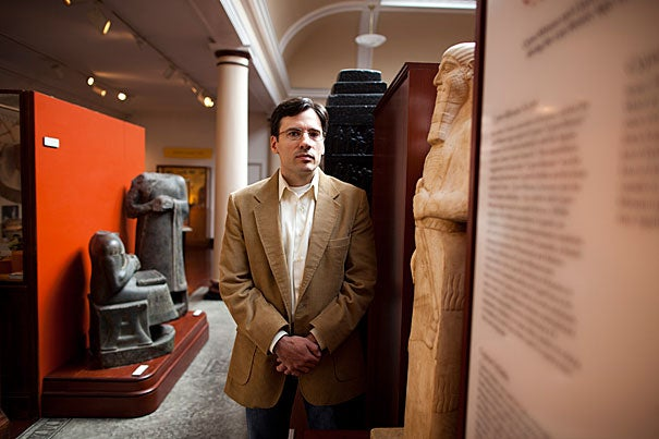 Benjamin Studevent-Hickman, a lecturer on Assyriology in Harvard's Department of Near Eastern Languages and Civilizations, spent months translating 4,000-year-old clay tablets, which are inscribed with cuneiform characters, that were looted from Iraq and stored in a basement at the World Trade Center when it collapsed on 9/11.