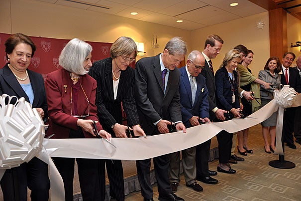 Participating in the traditional ribbon cutting were Associate Justice of the U.S. Supreme Court Elena Kagan '86 (from left), Dean Martha Minow, President Drew Faust, Professor Robert Clark '72, architect Robert A.M. Stern, Finn M.W. Caspersen Jr. '95, Barbara Caspersen, Samuel Caspersen '99, Emily Caspersen, Abby S. Milstein '76, and Howard Milstein '77.