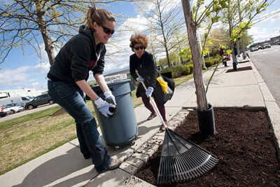 Harvard's GIS manager Parvaneh Kossari (right) and Sustainability Engagement Program manager Olivia Percy spread mulch at  Barry's Corner during Boston Shines, an annual event that University employees have participated in for the past 10 years.