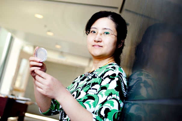 "Assistant Professor Yun Zhang, shown in the Northwest Science Lab last year, is working with colleagues to illuminate ""compartmentalized"" neural activity in worms."