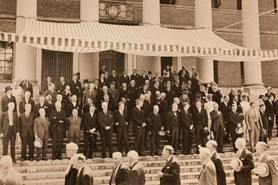 """In front of a festive Widener Library 70 years ago, alumni from a 19th-century class file past Harvard President James B. Conant, 1942 Commencement dignitaries, and members of the University's governing boards. """"The chain of graduated classes,"""" said Conant in his June 7, 1942 Baccalaureate sermon, """"now spans exactly 300 years."""""""