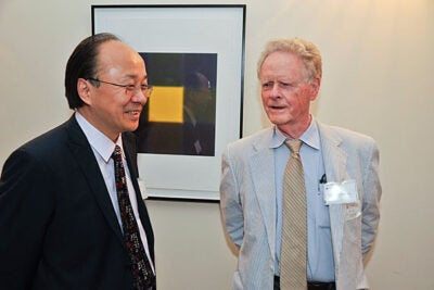 Xiao-Li Meng (left), Whipple V.N. Jones Professor of Statistics, speaks with Professor Arthur P. Dempster before the event that celebrated the inauguration of the Arthur P. Dempster Award and the 55th anniversary of the Harvard Statistics Department.
