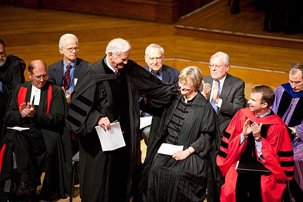 Former Harvard president Derek Bok greets current president Drew Faust at the Phi Beta Kappa Exercises inside Sanders Theatre. Two-time Poet Laureate of the United States and 2011 Pulitzer Prize winner Kay Ryan (not pictured) read 12 poems at the ceremony.