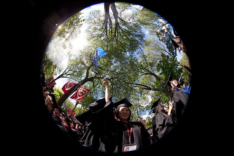 Joy Choi '12 celebrates Harvard's 361st Commencement in Tercentenary Theatre. Photographer Kris Snibbe documented the moment through a fish-eye lens. Kris Snibbe/Harvard Staff Photographer