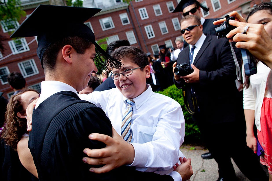 Eliot House graduate Oscar Zarate is congratulated by his family after he receives his degree. Stephanie Mitchell/Harvard Staff Photographer