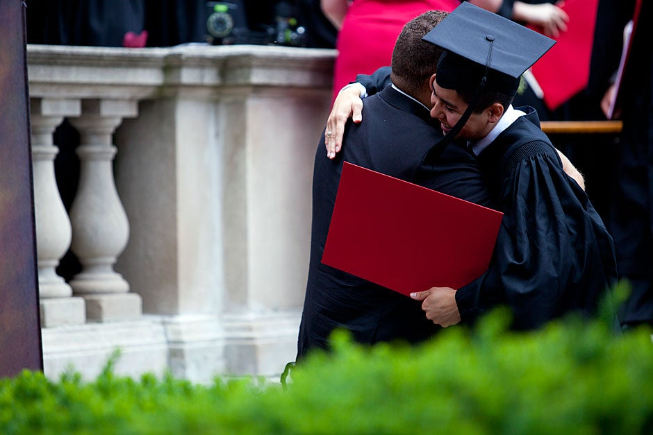 Eliot House graduate Oscar Zarate (right) is congratulated by a friend after he receives his degree. Stephanie Mitchell/Harvard Staff Photographer