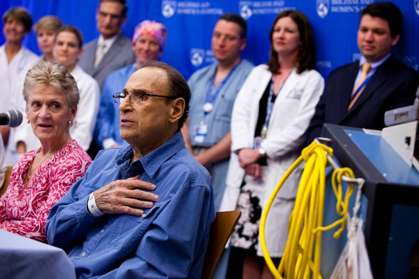 """It's not a difficult choice if you want to live, and I want to live,"" said Jim Carelli Jr., surrounded by the Brigham team that implanted his artificial heart."