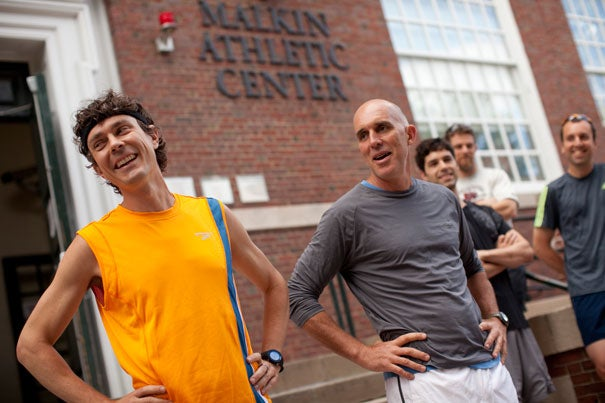 Nearly 80 runners joined authors and fitness authorities Scott Jurek (left) and Christopher McDougall '85 for a run along the Charles, an event sponsored by Harvard On The Move.