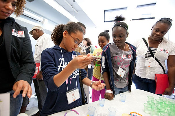 Michelle Tapia (from left), Brianna Valbrun (in yellow shirt), and Rachelle Brown-Mitchell, all of the  E. Greenwood Leadership Academy, participated in a Harvard 2012 Step UP/Project TEACH event, which hosted students and families from the Hennigan Elementary School and the E. Greenwood Leadership Academy for a college readiness program at Harvard's Science Center.