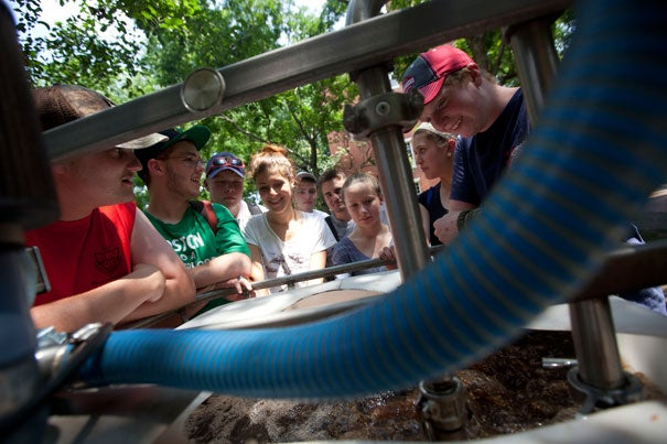 "Norfolk County Agricultural High School students watch the brewing of organic fertilizer ""tea"" by Harvard Landscape Services during a visit to Harvard Yard. The field trip was part of a four-week program in partnership with the Arnold Arboretum."
