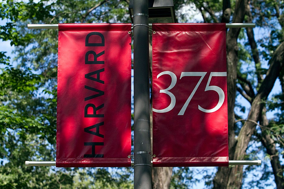 Banners hanging in Tercentenary Theatre proclaim Harvard's 375th anniversary. Jon Chase/Harvard Staff Photographer