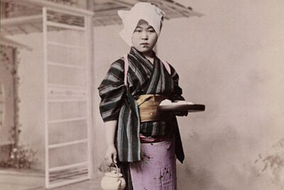 "Tamamura Kozaburo's ""Woman holding tea set,"" a hand-colored albumen print mounted on album page, is one of the more than 2,000 images in the virtual exhibit ""Early Photography of Japan."""