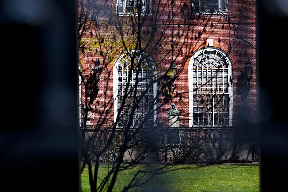 Through the ornately decorated gate, one catches a glimpse of the Eliot House courtyard. Stephanie Mitchell/Harvard Staff Photographer