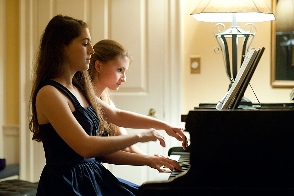 High Table dinner at Lowell House. Twins Danielle '14 (left) and Arielle Rabinowitz '14 perform a piano duet before a black-tie High Table dinner at Lowell House. Jon Chase/Harvard Staff Photographer