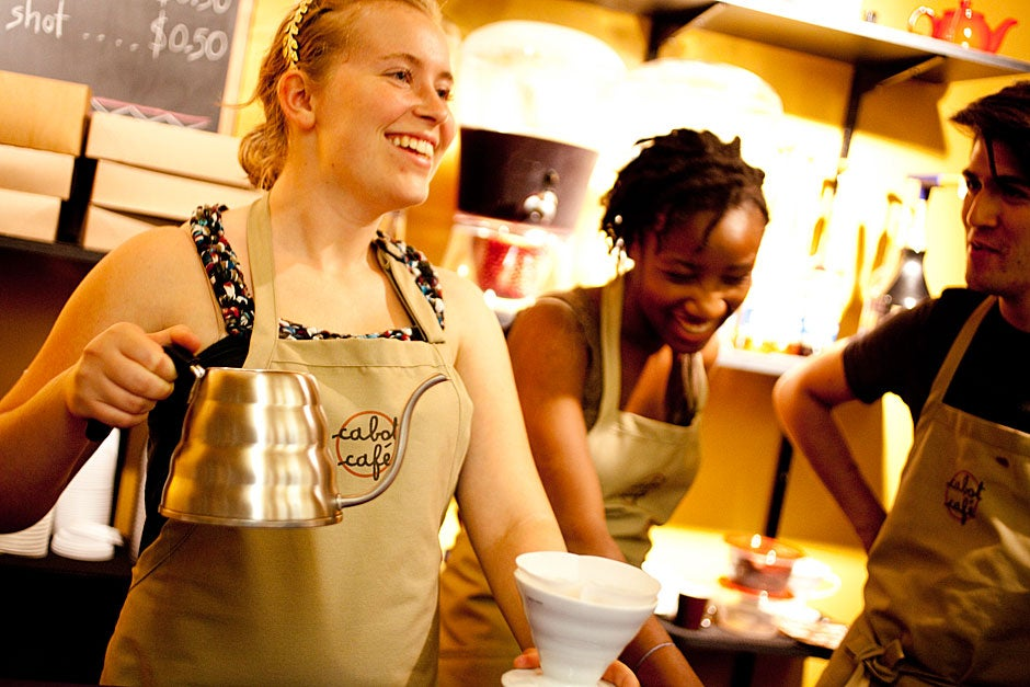 Baristas Anna Menzel '15 (from left), Marie-Fatima Hyacinthe '14, and Nicolas Jofre '13 serve coffee at the Cabot Cafe in the basement of Cabot House. Rose Lincoln/Harvard Staff Photographer