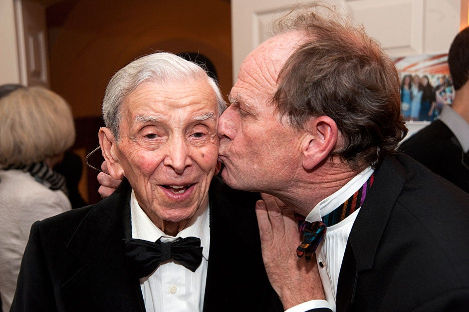 Musician and former Lowell House artist-in-residence Livingston Taylor (right) plants a kiss on the cheek of Maurice Pechet, former researcher and professor at Harvard Medical School. Pechet, who passed away in March 2012 at the age of 95, spent 70 years at Harvard, and mentored generations of students and biochemists. Jon Chase/Harvard Staff Photographer