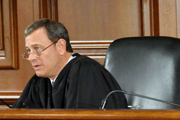 Chief Justice John Roberts, a conservative justice nominated by President George Bush in 2005, sided with the court's more liberal members in the decision. Roberts (pictured) '76, J.D. '79, returned to Harvard Law School in 2010 to take part in its historic moot court event.