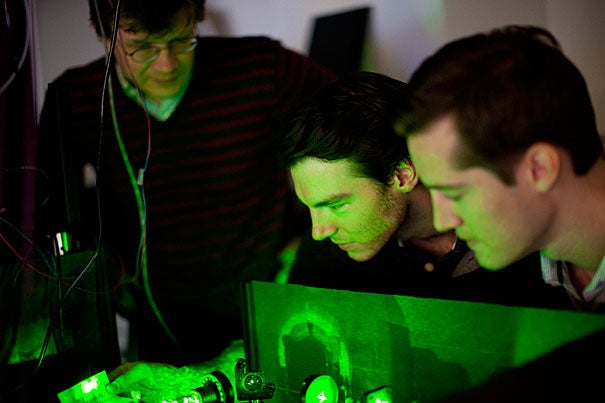 Mikhail Lukin (from left), Georg Kucsko, and Christian Latta are part of a group of Harvard scientists who were able to create quantum bits and store information in them for nearly two seconds, an increase of nearly six orders of magnitude over the life span of earlier systems. The work has a number of potential applications, including the eventual construction of a functional quantum computer.