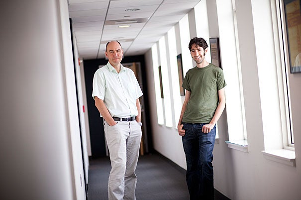 """Many people are dying needlessly of cancer, and this research may offer a new strategy in that battle,"" said Martin Nowak (left), director of the Program for Evolutionary Dynamics. Nowak and his team, including Benjamin Allen (right), a postdoctoral fellow in mathematical biology, focused on a multidrug approach to treatment that could make many cancers manageable, if not curable."