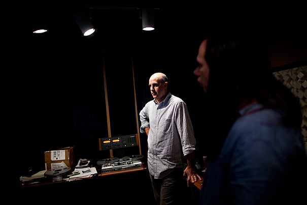 Audio engineers work in Harvard's Audio Preservation Studio with its tape decks, turntables, and computers. Media technician Darron Burke (left) and David Ackerman (right), who directs Harvard's high-tech audio studio, have digitized field recordings made in the 1930s on aluminum discs.