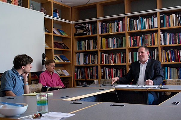 Activist and Harvard Kennedy School (HKS) lecturer Tim McCarthy (right) discussed the pervasive stigma against sexual minorities, both in the United States and abroad, with Philip Hamilton (from left), a recent Wheaton graduate working with the Carr Center, and Dorothy Zinberg, an HKS lecturer in public policy.