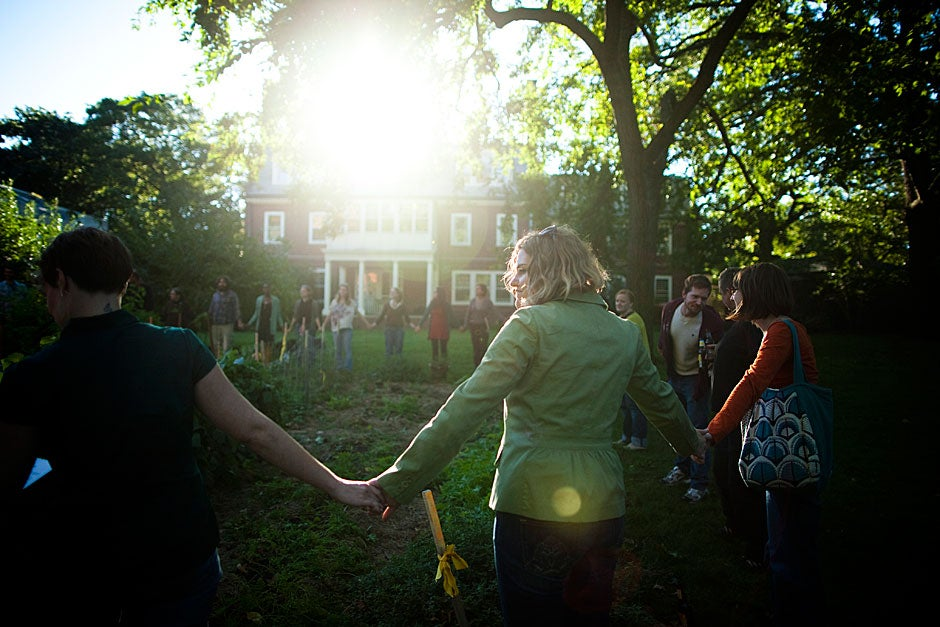 Members of the Harvard Divinity School community hold hands and enshroud their garden to dance and pray in thanks for harvested vegetables. Stephanie Mitchell/Harvard Staff Photographer