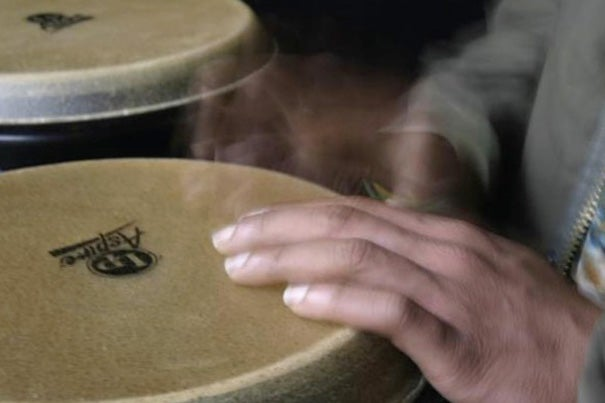 Ghanaian drummer Agbenyega Attiogbe-Redlich plays to a metronome, but like all humans, his beats are slightly off rhythm. Physicists have discovered these misbeats follow a pattern.