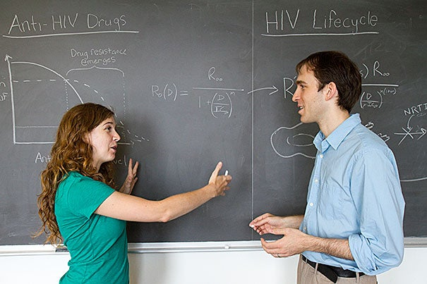 """Harvard's Alison Hill and Daniel Rosenbloom, along with Professor Martin Nowak (not pictured), have shown that the relationship between adherence to a drug regimen and resistance is different for each of the drugs that make up the """"cocktail"""" used to control HIV. """"What we demonstrate in this paper is a prototype for predicting, through modeling, whether a patient at a given adherence level is likely to develop resistance to treatment,"""" said Hill."""