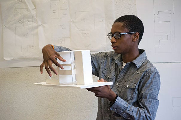 Patrick Joseph shows the model he made of a residential building that doubles as an art studio. His design was made during Project Link, a four-week program that immerses 10th- through 12th-grade students from Greater Boston in the world of design. Since Project Link's inception, program leaders have targeted regional high schools that don't have art or architecture programs.