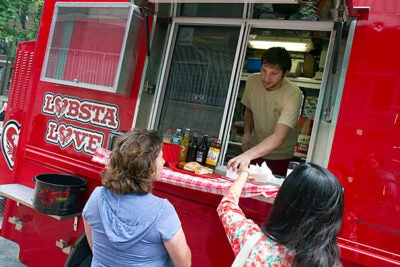 Lobsta Love's Sam Williams gives his customers the best in New England cuisine. On Tuesdays and Sundays the food trucks make their way to Harvard's campus, bringing their unique menus and character along for the ride.