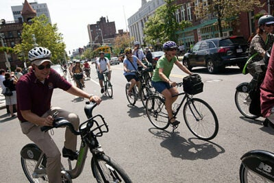 Associate Director of Harvard University Parking Services Jim Sarafin (far left) rides with a train of bicyclists today as part of the Hubway bike-share program. The program has been expanded to include more nearby communities.