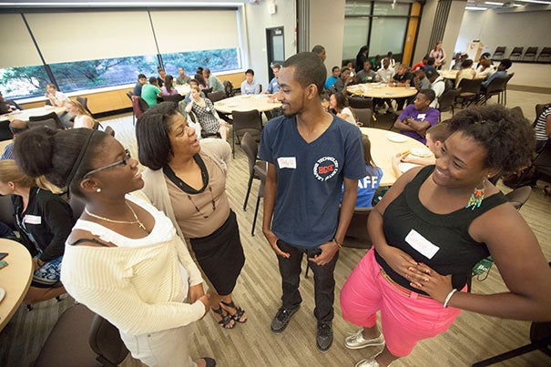 Discussing the benefits of Harvard's summer jobs program are Thelora Marseille (from left), who this fall will attend the University of Massachusetts, Boston; Lisa Maxwell, assistant director of employment at HGSE; Tewodrose Woldemariam, who will attend Regis College; and Eunice Offre, who is bound for Colby-Sawyer College.