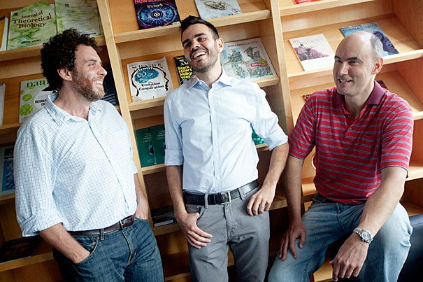 In a series of experiments, Harvard researchers found that people who make quick decisions act less selfishly than those who deliberate. Joshua Greene (from left), the John and Ruth Hazel Associate Professor of the Social Sciences, David Rand, a postdoctoral fellow in psychology, and Martin Nowak, professor of mathematics and of biology, published their findings in the Sept. 20 issue of Nature.