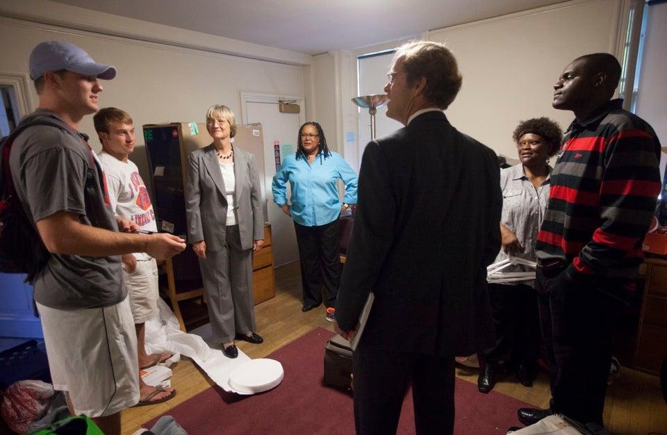 Jameson McShea `16 (from left), Paul Stanton `16, Harvard President Drew Faust, Harvard College Dean Evelynn M. Hammonds, Dean of Freshmen Thomas Dingman, Esther Ojogho, and her son, Dennis, talk during Move-In Day.