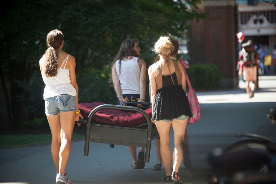 Members of the Class of `16 work together to carry a bed into Harvard Yard. Rest easy, freshmen!