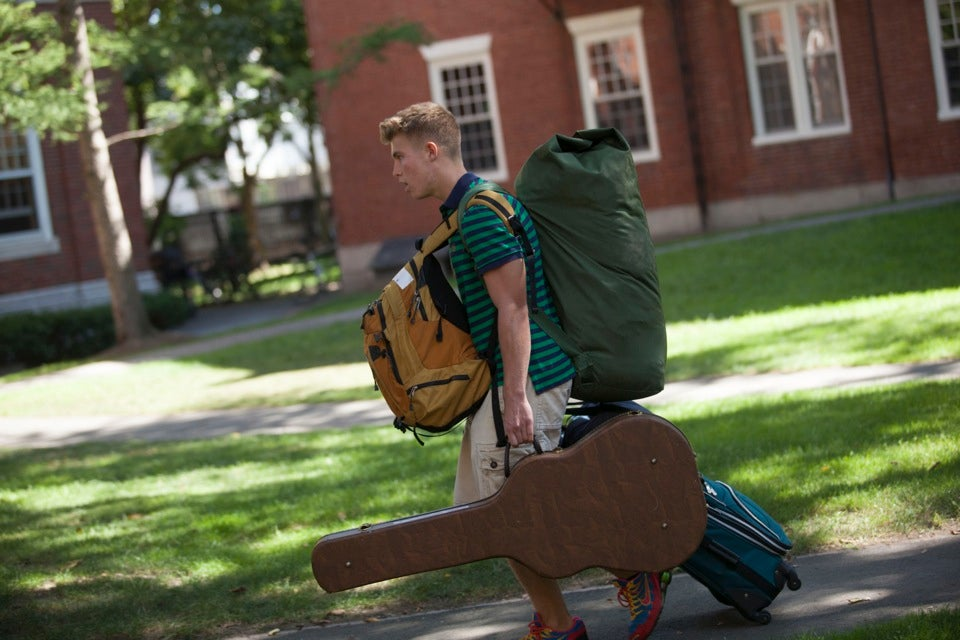 Packed bags? Check. Guitar? Check. Dan Rittenhouse `16 transports his belongings into his new home.