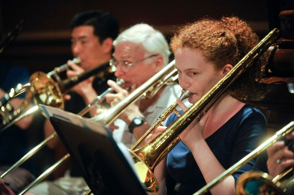 The 40th annual Harvard Summer Pops Band practices at Sanders Theatre.  One of the first open community bands in the area, it continues to attract local music lovers of all ages.  Jon Chase/Harvard Staff Photographer