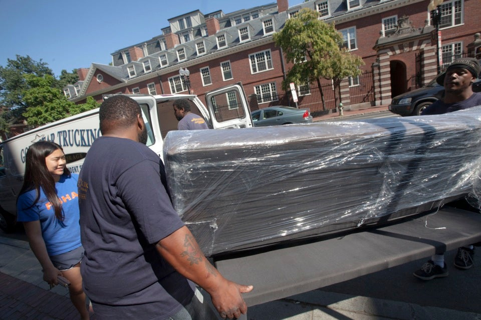Movers assist Edith Chan `12-`13 in moving into her new home:  Fairfax Hall.