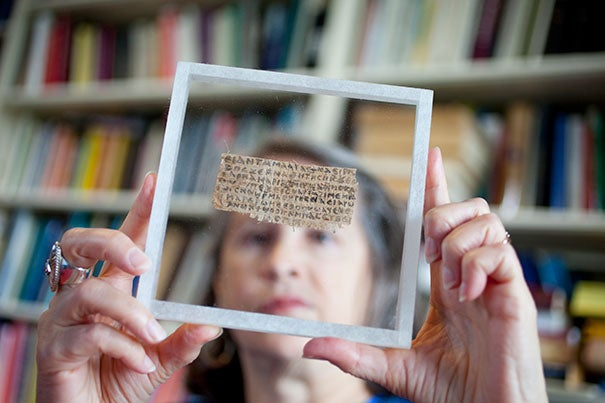 """Harvard Professor Karen King with the previously unknown papyrus fragment that, when translated, contains """"Jesus said to them, my wife.""""  """"This new gospel doesn't prove that Jesus was married, but it tells us that the whole question only came up as part of vociferous debates about sexuality and marriage,"""" said King."""