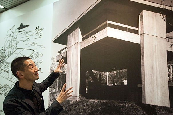 """Guest curator Ken Tadashi Oshima points out the elements that make Sky House unique. Its open, flexible floor plan — with verandas on all four sides — recalls the style of traditional Japanese interiors. The image is part of """"Tectonic Visions Between Land and Sea,"""" a room-filling, eye-filling exhibit at Gund Hall."""