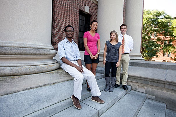 Seniors Abiola Laniyonu (from left), Laura Hinton, Meghan Joy Smith, and Matthew Chuchul have been awarded the David and Mimi Aloian Memorial Scholarships from the Harvard Alumni Association.