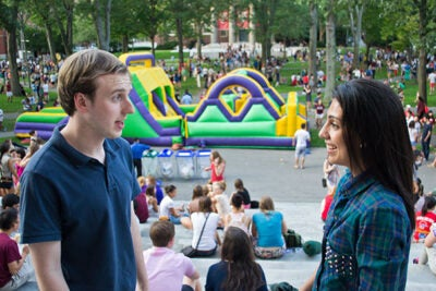 "Freshmen AJ Unitas Jr. (from left) and Amna Hashmi catch up on the steps of Widener Library as the ""Welcome Back Event"" gets into full swing, bounce house included."